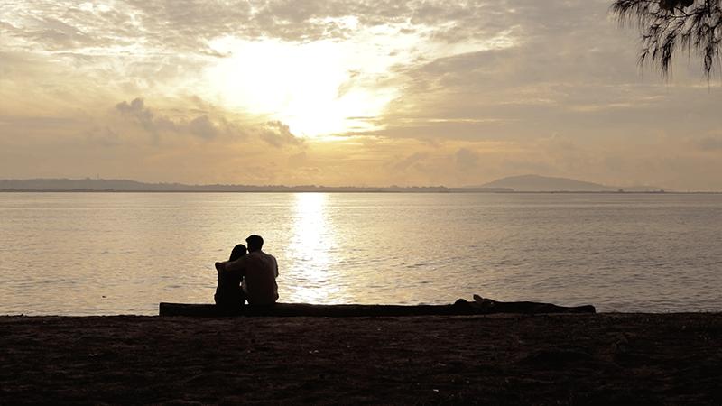 couple sunset beach